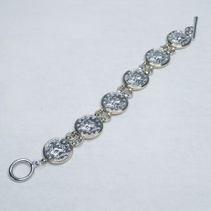 Vintage silver and gold tone coin link bracelet
